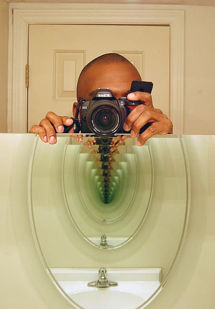 "An ""imperfect mirror"" will have greenish color at the end of the mirror tunnel."