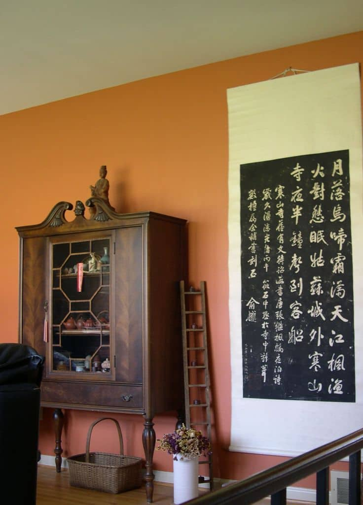 The artwork and furniture is highlighted by the color of the wall.