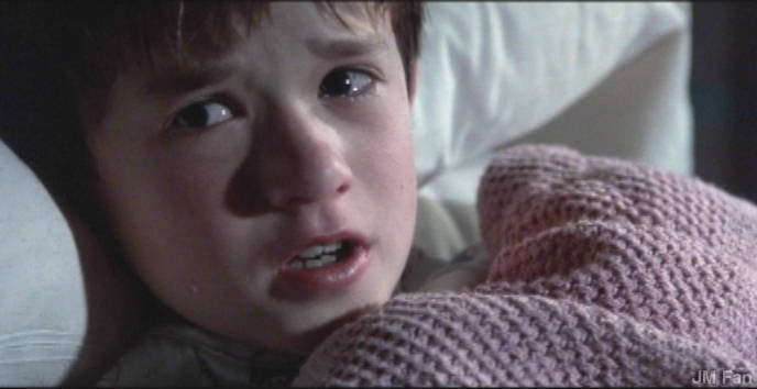 "A scene from the movie ""The Sixth Sense."" Many movies depict children engaging some other-worldly beings. It is said that they are more approachable because they have yet to grow to their full strength."