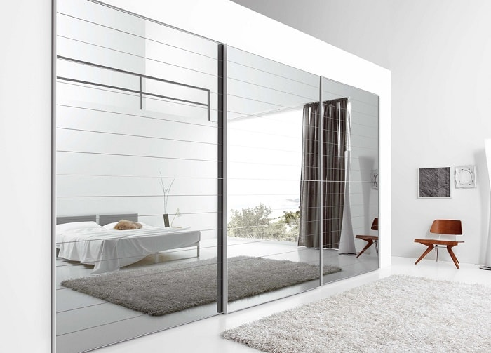 A Feng Shui Tip For Mirrored Closet Doors Reflecting Bed