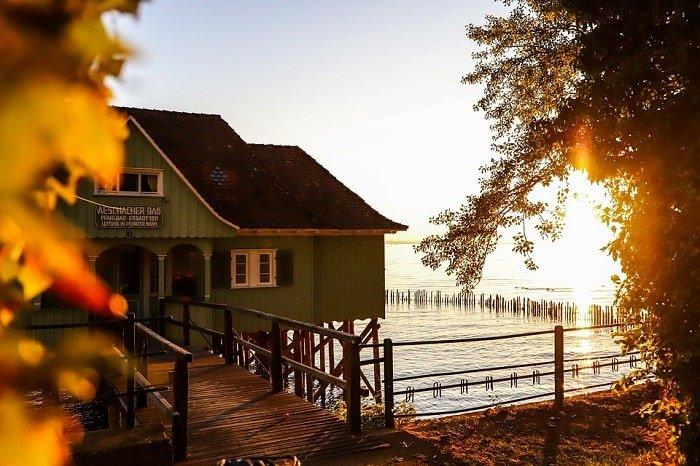 house sunset on water-min